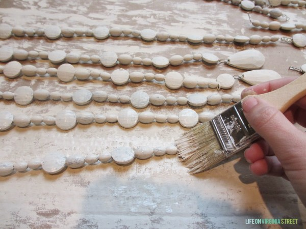 how to make beads look like wood for a wood bead chandelier, Life on Virginia Street on Remodelaholic