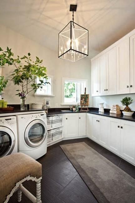 large open laundry space with beautiful light fixture featured on Remodelaholic.com
