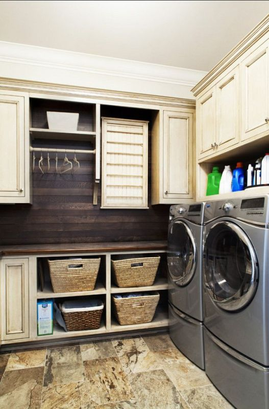 laundry with lots of storage space and hanging rack featured on remodelaholic.com