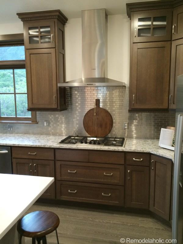 Walnut kitchen with Stainless steel tile backsplash