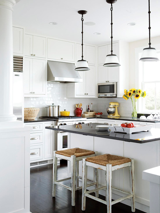 U shaped kitchen layout in white with subway tile via BHG