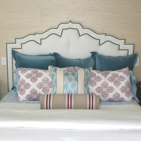 custom ornate arched trellis headboard with nailhead trim via Newport Harbor Home Tour