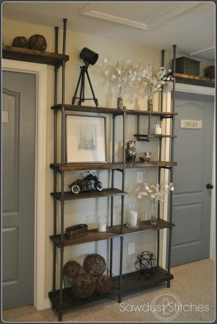 finished-vintage-industrial-shelf-made-with-inexpensive-PVC-pipe-Sawdust-2-Stitches-on-Remodelaholic