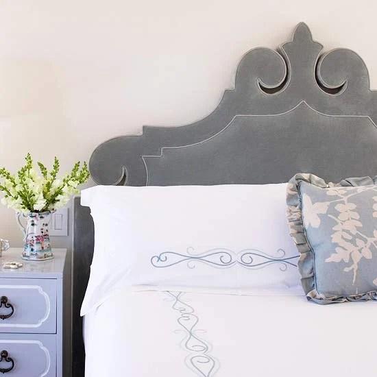 gray velvet carved ornate headboard via BHG