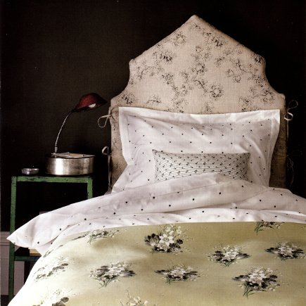scooped peaked upholstered headboard via Attic Mag