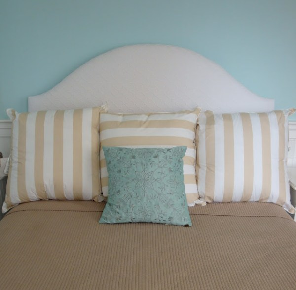 simple arched white headboard tutorial via Remodelaholic
