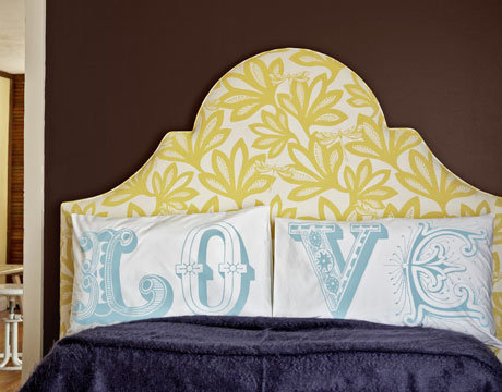 simple cathedral scooped keystone headboard in green flower print via Country Living