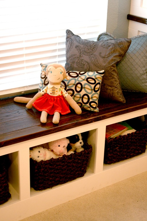 great wall of built-ins with toy storage bench and cupboards, Remodelaholic