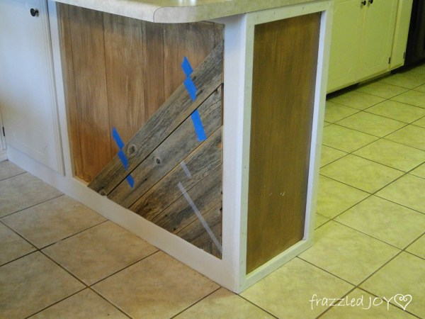 use painter's tape to hold planks to kitchen island, Frazzled Joy on Remodelaholic