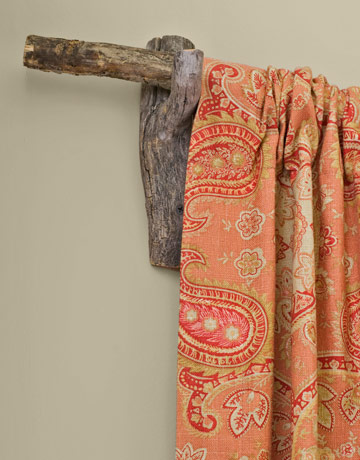 Country Living natural branch curtain rod via Remodelaholic