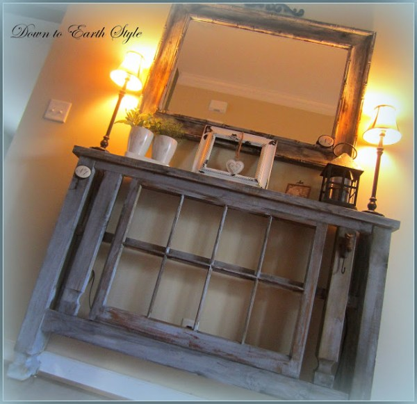 Down to Earth Style - old window in a foyer table console - via Remodelaholic