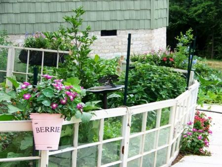 Flower Garden Girl - old window vegetable garden fence - via Remodelaholic