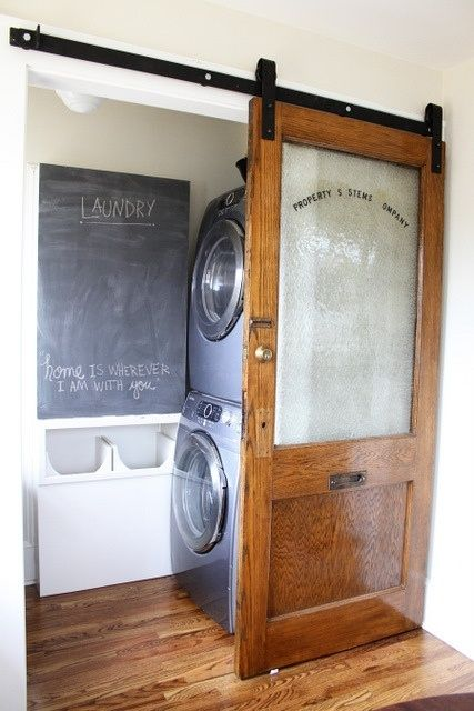 Great hidden laundry room using a barn door featured on Remodelaholic.com
