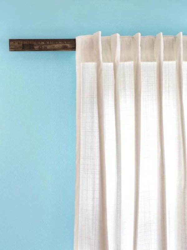 HGTV use yardstick as a curtain rod via Remodelaholic