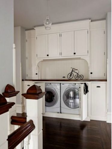 Hallway Laundry Space built in hidden laundry