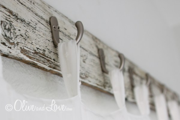 Olive and Love reclaimed wood curtain hooks via Remodelaholic
