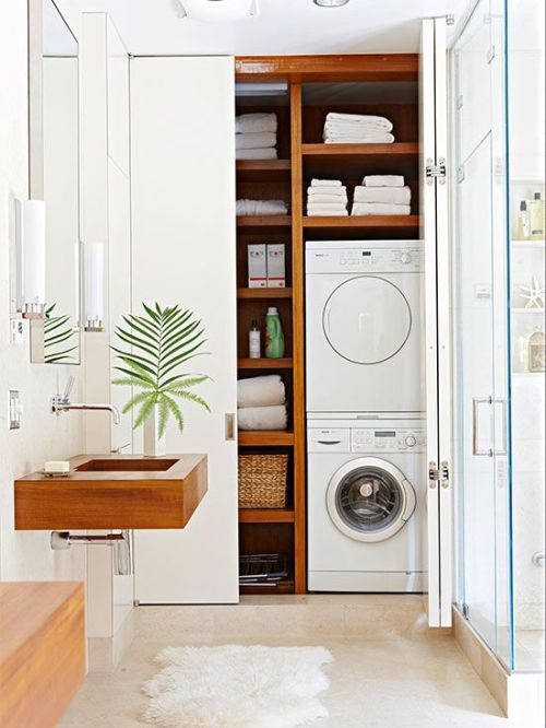 Share Powder Room with Laundry and hide it behind closet doors featured on Remodelahoilc.com