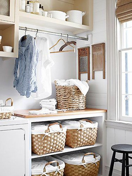air drying space in pretty laundry room with baskets too featured on Remodelaholic.com