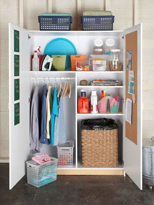 cute cabinet to hide all of the extra laundry necessities