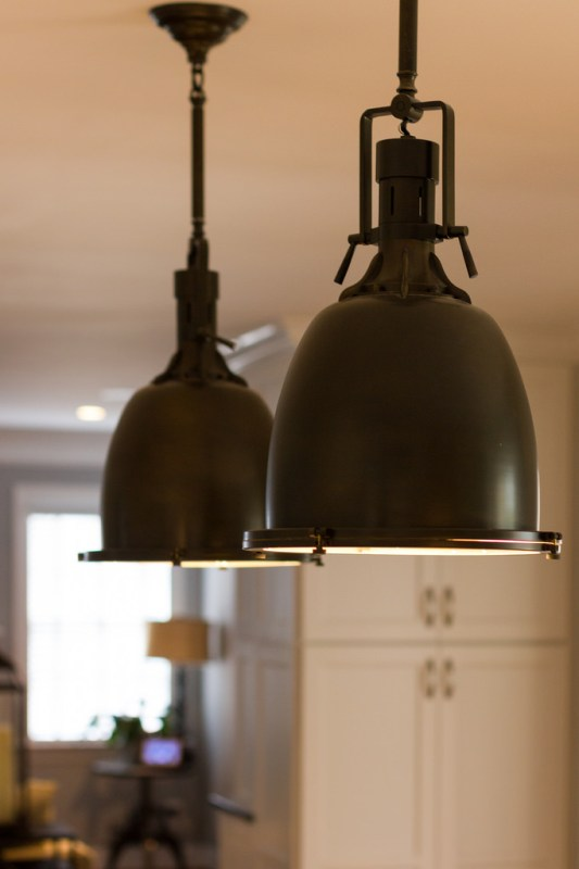 industrial brass lighting in a white kitchen renovation