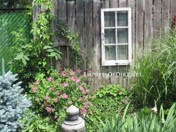 via Empress of Dirt - old window hung on fence - via Remodelaholic