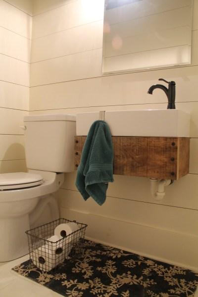 Girl Meets Carpenter bathroom makeover with wooden floating sink pedestal