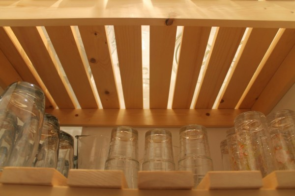 underneath view of wood slat pantry shelving, Girl Meets Carpenter on @Remodelaholic
