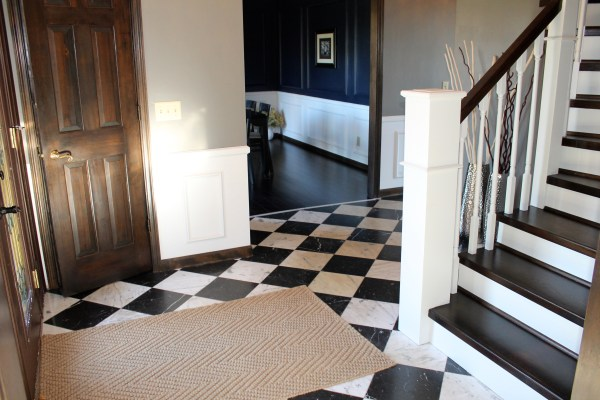 tile checker entryway with wood and white curved staircase - Construction2Style via @Remodelaholic