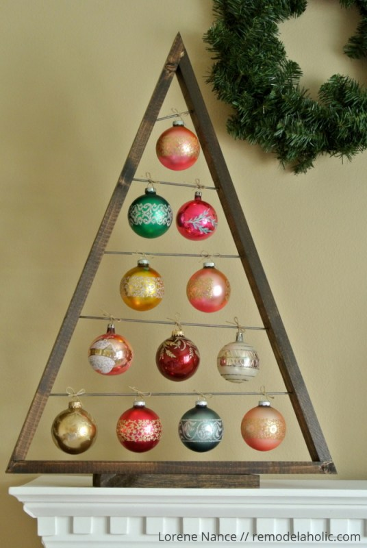 Knockoff the Crate and Barrel wood ornament display tree for a fraction of the price using these free plans! Use it as an advent calendar or as a replacement for a traditional tree. Perfect for vintage and special ornaments. #remodelaholic #christmasdiy #diyChristmastree