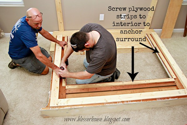 build a faux fireplace using a salvaged mantel - Blesser House featured on @Remodelaholic