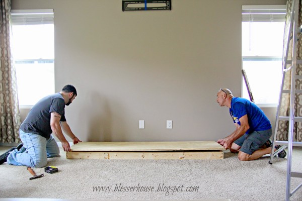 building the hearth base for faux fireplace - Blesser House featured on @Remodelaholic