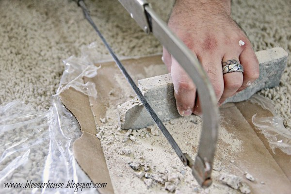cut airstone for faux fireplace - Blesser House featured on @Remodelaholic