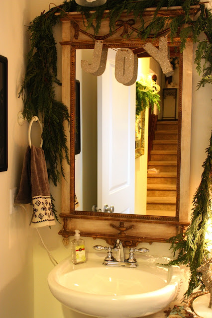 evergreen boughs and garland for Christmas bathroom decor - My Sweet Savannah via @Remodelaholic