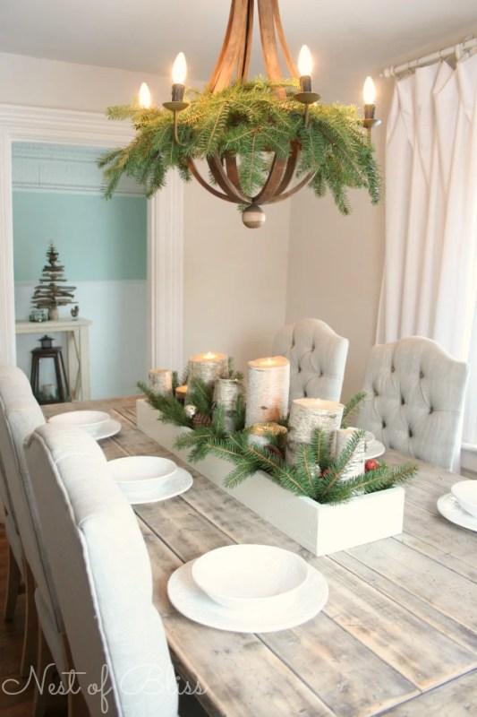 evergreen boughs in the dining room chandelier - Nest of Bliss via @Remodelaholic