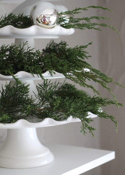 fresh fir and pine branches on a cake plate dish - 12th and White via @Remodelaholic