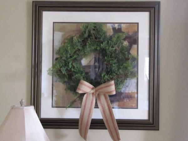 hang a wreath on framed art - Sew Many Ways via @Remodelaholic