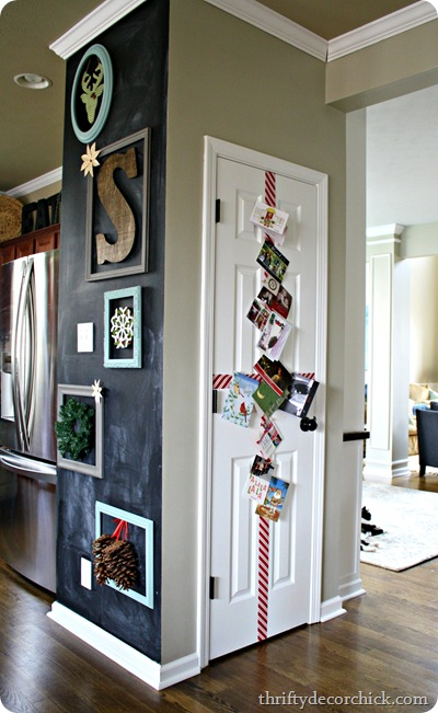 holiday gallery wall and card display on door - Thrifty Decor Chick via @Remodelaholic