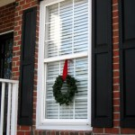 how to hang a wreath on the outside of a window - Bova Goods via @Remodelaholic