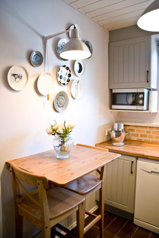 industrial wall light over breakfast table in small kitchen - Pudel-design featured on @Remodelaholic