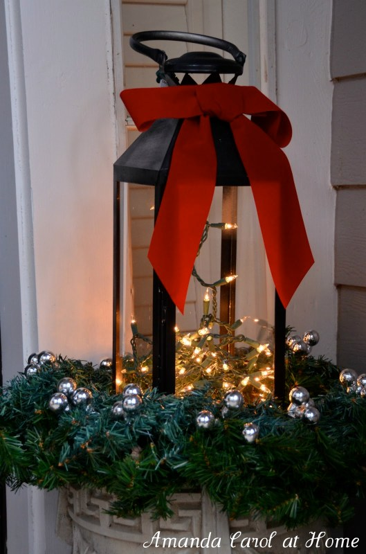 lantern in outdoor planter for winter, Amanda Carol at Home via @Remodelaholic