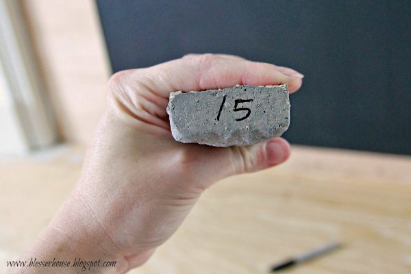 number stones after dryfit for diy faux fireplace - Blesser House featured on @Remodelaholic
