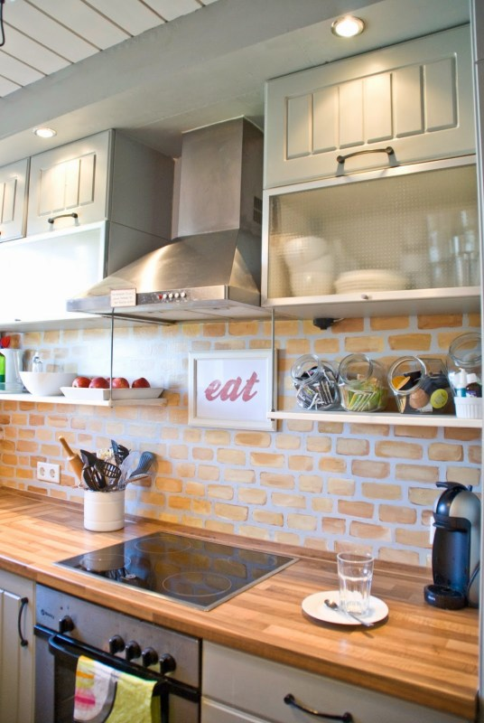painted faux brick backsplash with wood countertops - Pudel-design featured on @Remodelaholic