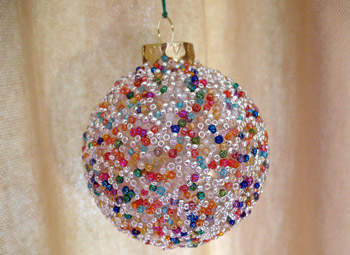 Beaded ornament - Try these 35+ DIY ideas for clear glass ornaments to add precious memories and lots of spirit to your Christmas tree! from @tipsaholic #ornaments #diy #christmas