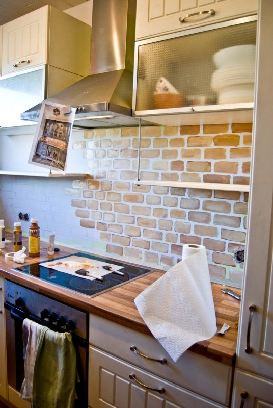 small kitchen with painted faux brick backsplash - Pudel-design featured on @Remodelaholic