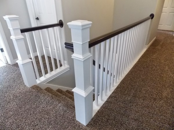 stair banister renovation build around existing newel post and handrail - TDA Decorating and Design featured on @Remodelaholic