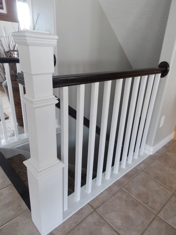 stair newel post built around builder-grade banister - TDA Decorating and Design featured on @Remodelaholic