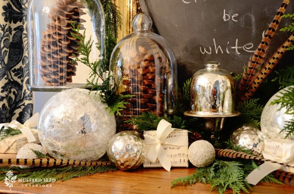 tuck sprigs of evergreen into mantel decorations - Miss Mustard Seed via @Remodelaholic