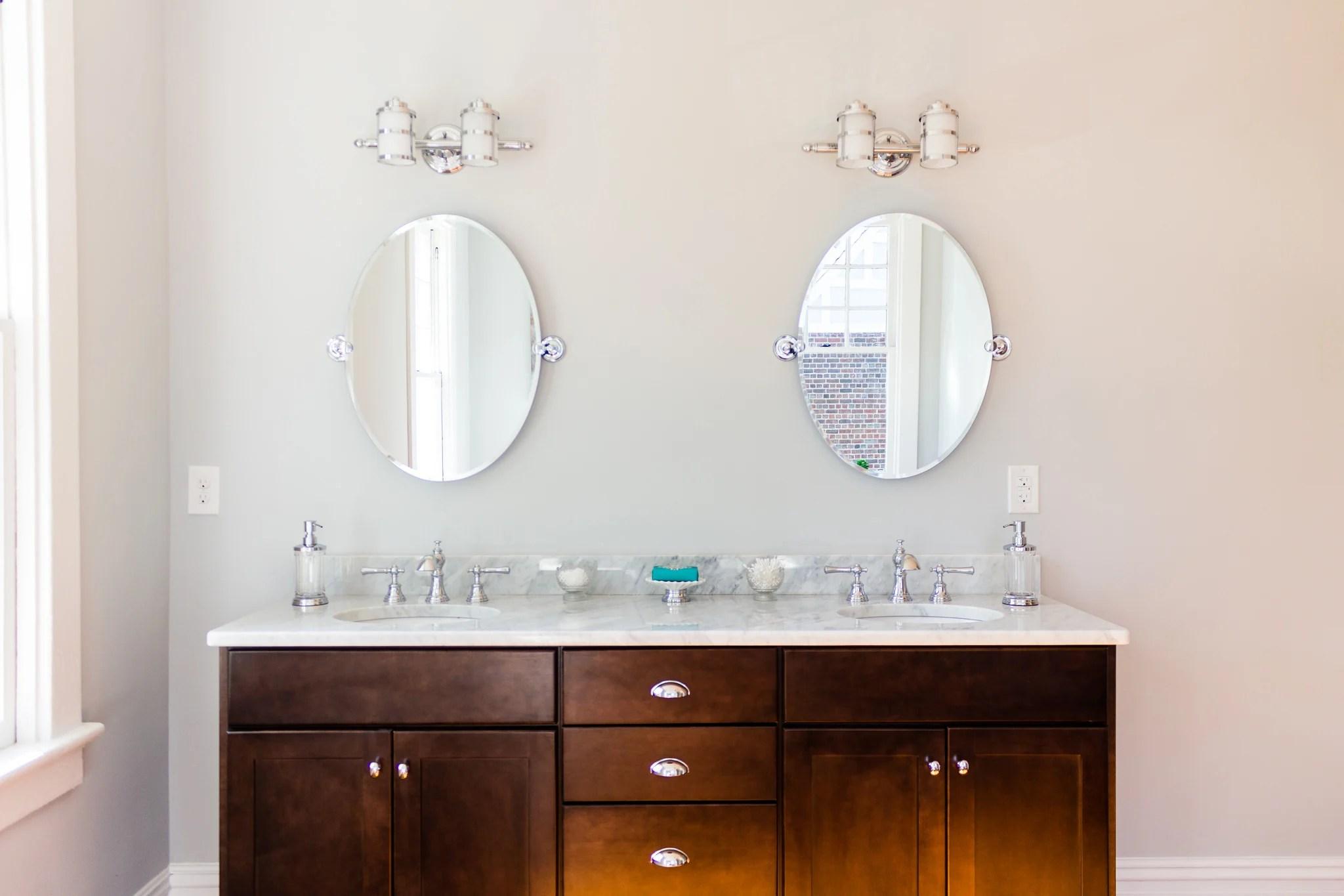 hawthorne spacious open bathroom with wood floor dark espresso double vanity mirrors remodelaholic