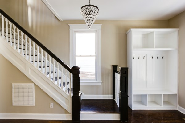 Inviting Entryway (Griffin) @Remodelaholic built-in coat locker cubbies, walnut floor and stairs