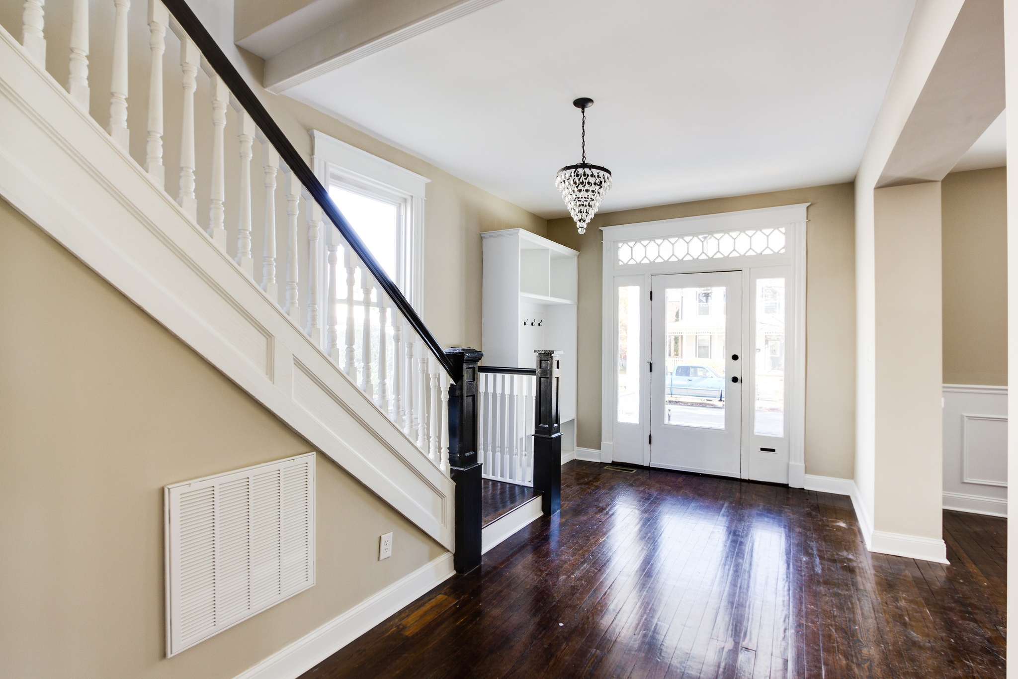 Inviting Entryway With Dark Walnut Floors And Built In Storage (Griffin)  @Remodelaholic